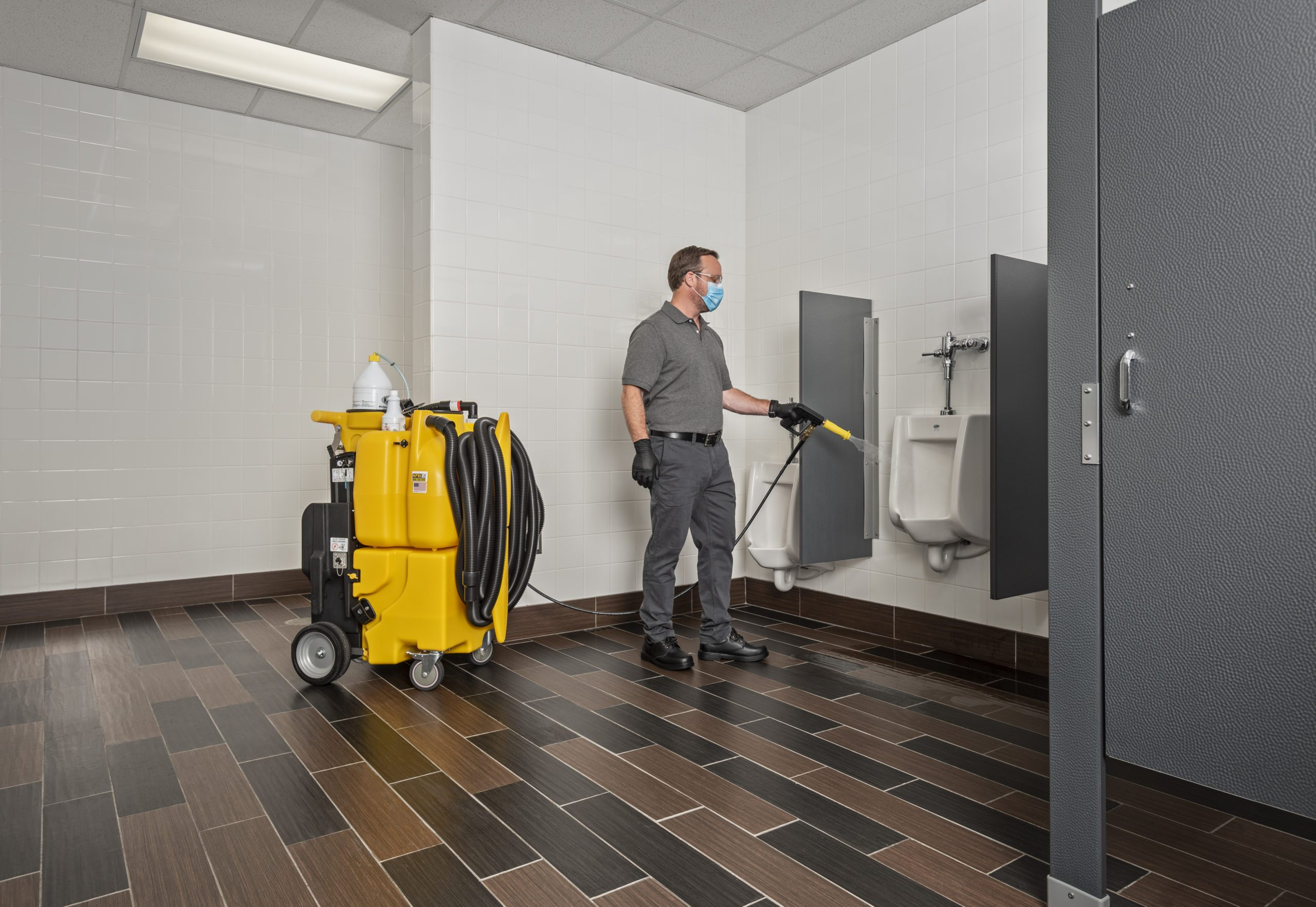 Cleaning public toilets with Kaivac No-Touch Cleaning system