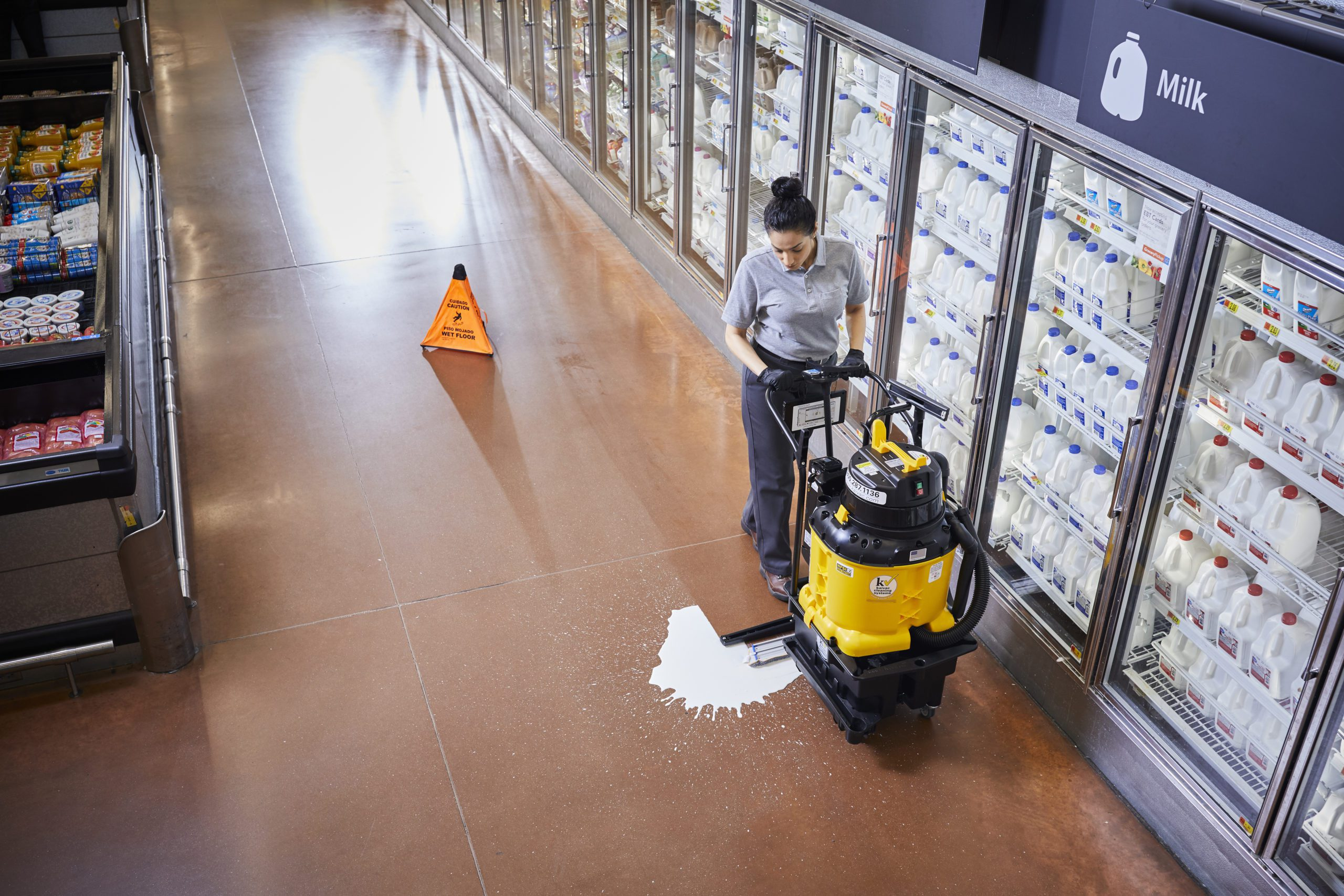 cleaning spills from grocery store floors